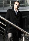 Man in Suit and Black Coat