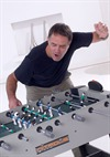 Male Playing Table Football