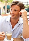 Young Man Enjoying a Cup of Coffee