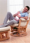 Male Model Relaxing With Baby