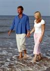 Couple Walking On The Rocks
