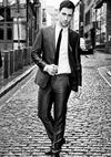 Man Walking In A Suit